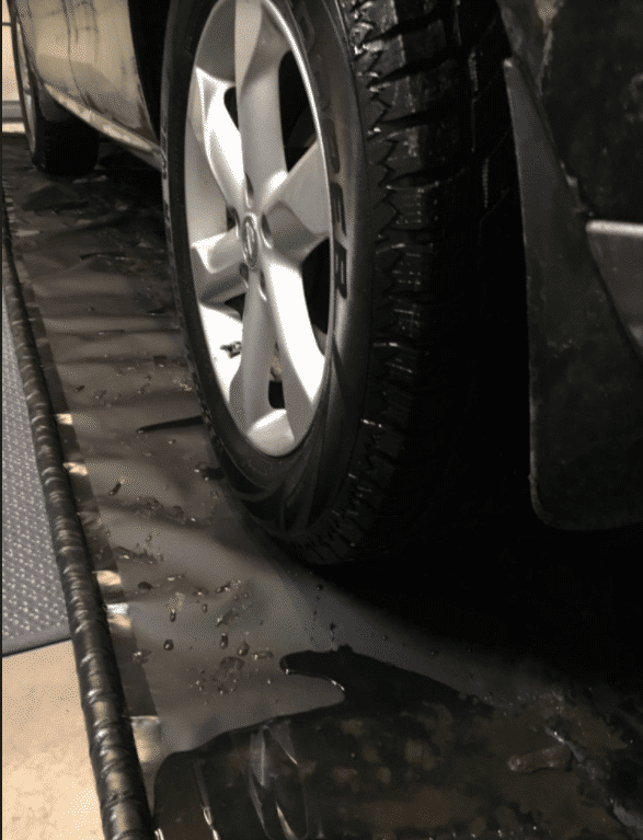 Vehicle parked on AutoFloorGuard - garage floor containment mat - AutoFloorGuard reviews