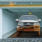 Top garage accessories you need in cold climates - truck parked on AutoFloorGuard garage floor containment mat